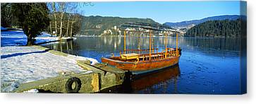 Traditional Boat Docked At A Port, Lake Canvas Print by Panoramic Images
