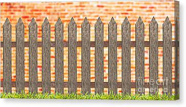 Traditional Fence With Grass And Brick Wall Canvas Print by Pakorn Kitpaiboolwat
