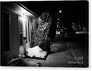 Traditional House With Porch Light Outside The Door And Snow Cleared Pavements At Night Delisle Sask Canvas Print