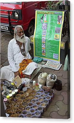 Traditional Indian Medicine Seller Canvas Print by Mark Williamson