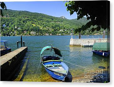 Traditional Lucia Fishing Boat On Lake Maggiore Canvas Print by Brenda Kean