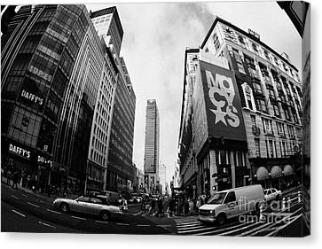 traffic crossing intersection outside Macys at Broadway and 34th Street Herald Square new york usa Canvas Print by Joe Fox