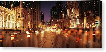 Traffic On The Road At Dusk, Michigan Canvas Print by Panoramic Images