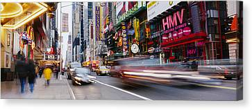 Traffic On The Street, 42nd Street Canvas Print by Panoramic Images
