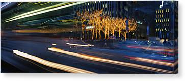 Traffic On The Street At Night, Sixth Canvas Print by Panoramic Images