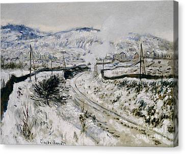 Train In The Snow At Argenteuil Canvas Print by Claude Monet