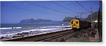 Train On Railroad Tracks, False Bay Canvas Print by Panoramic Images