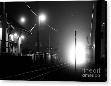 Trains Arriving Canvas Print by Steven Macanka