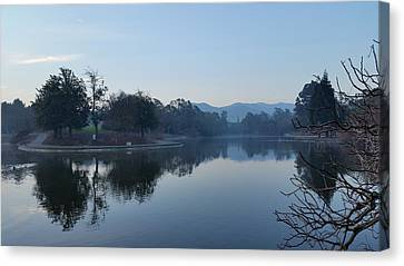 Tranquil Lake Canvas Print by Remegio Onia