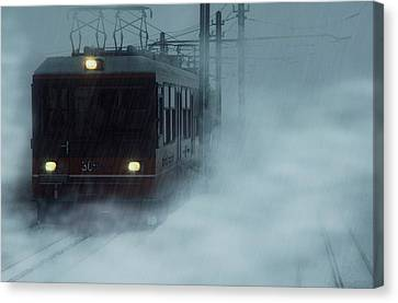 Traveling In The Snow... Canvas Print by Vittorio Chiampan