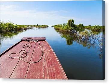 Traveling Through Tonle Sap Lake Canvas Print by Alexey Stiop