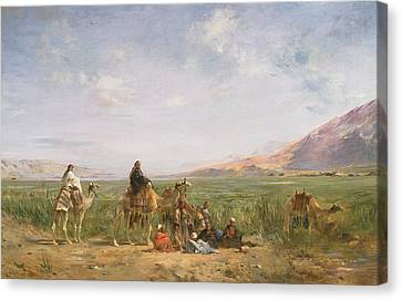 Travellers Resting At An Oasis Canvas Print by Eugene Fromentin