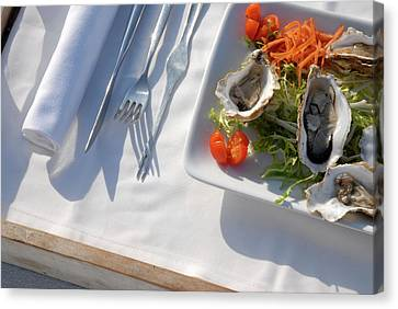 Raw Oyster Canvas Print - Tray With Oysters And A Fruit Juice by Nano Calvo