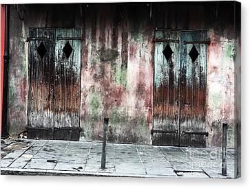 Triangle Doors Canvas Print by John Rizzuto