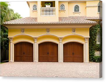 Triple Garage Doors Canvas Print by Les Palenik