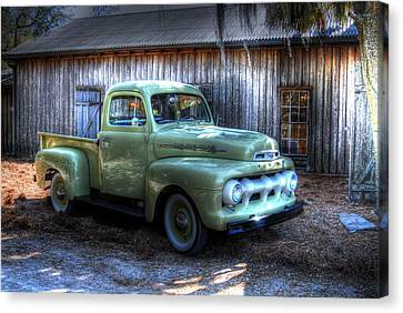 Truck By The Barn Canvas Print by Donald Williams