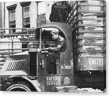 Truck Driver In His Cab Canvas Print by Underwood Archives