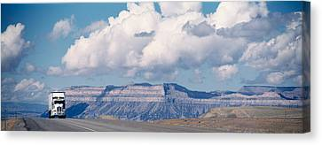 Truck On The Road, Interstate 70, Green Canvas Print by Panoramic Images