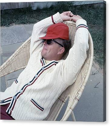 Truman Capote Leaning Back In A Chair Canvas Print