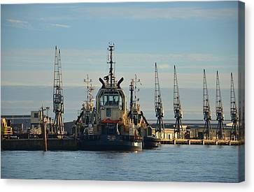 Tug Boat And Cranes Canvas Print by Malcolm Snook