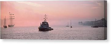Tugboat And Tall Ships In The Ocean Canvas Print by Panoramic Images