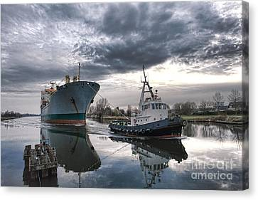 Water Vessels Canvas Print - Tugboat Pulling A Cargo Ship by Olivier Le Queinec