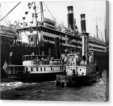 Tugboats Beside Bigger Ship Canvas Print by Retro Images Archive