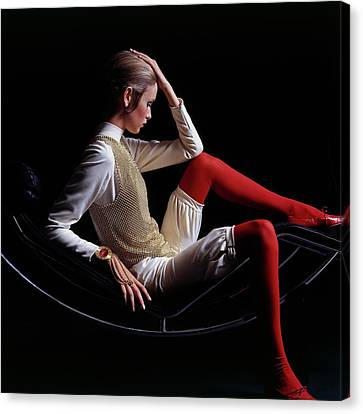 Twiggy Sitting On A Modern Chair Canvas Print by Bert Stern