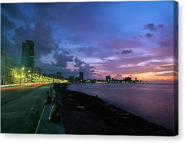 Twilight View Of Young Cubans Sitting Canvas Print by Steve Winter