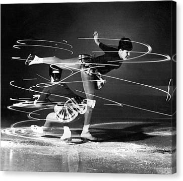 Twirling Lights And Spins On Ice Canvas Print by Underwood Archives