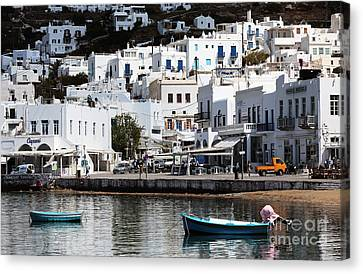 Two Boats In Mykonos Canvas Print by John Rizzuto