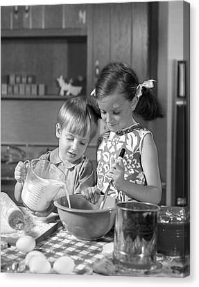 Two Children Baking, C.1960s Canvas Print by H. Armstrong Roberts/ClassicStock