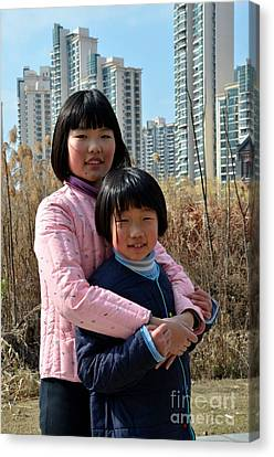 Two Chinese Teen Sisters Hug  And Embrace Shanghai China Canvas Print