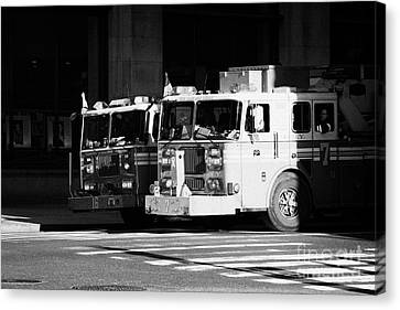 two FDNY fire engines 16 and 7 wait beside crosswalk 34th Street new york city Canvas Print by Joe Fox