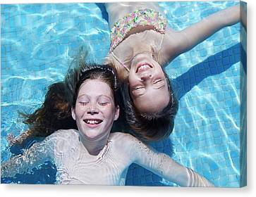 Floating Girl Canvas Print - Two Girls Floating In Water by Ruth Jenkinson