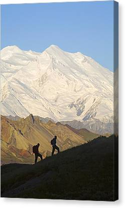 Two Hikers View Mckinley At Grassy Pass Canvas Print by Jeff Schultz