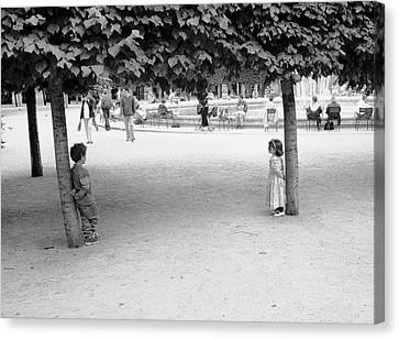 Two Kids In Paris Canvas Print by Dave Beckerman