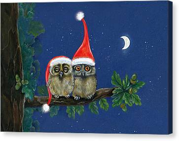 two little owls with Christmas caps Canvas Print by Marina Durante