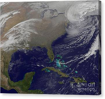 Two Low Pressure Systems Merge Together Canvas Print by Stocktrek Images