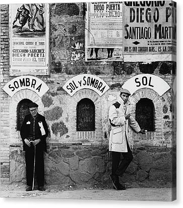 Two Men Posing By A Wall Covered In Spanish Canvas Print