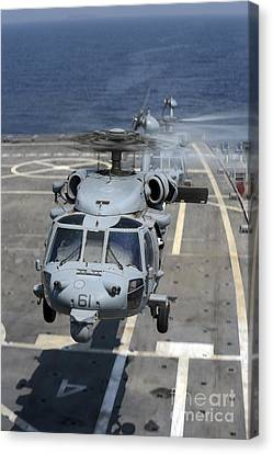 Two Mh-60s Sea Hawk Helicopters Take Canvas Print by Stocktrek Images