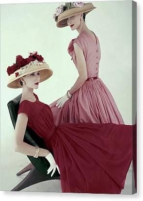 Furniture Canvas Print - Two Models Wearing Red Dresses by Karen Radkai