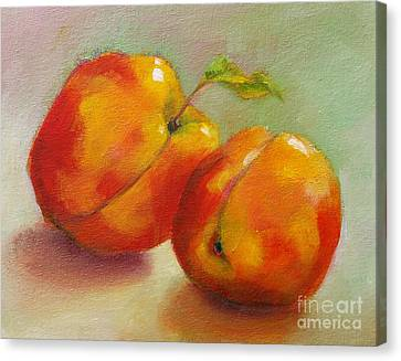 Two Peaches Canvas Print by Michelle Abrams