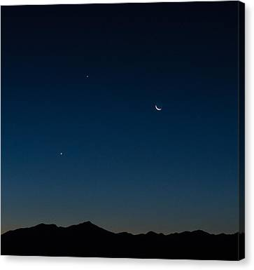 Two Planets And A Moon Canvas Print by Carolina Liechtenstein