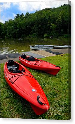 Two Red Kayaks Canvas Print by Amy Cicconi