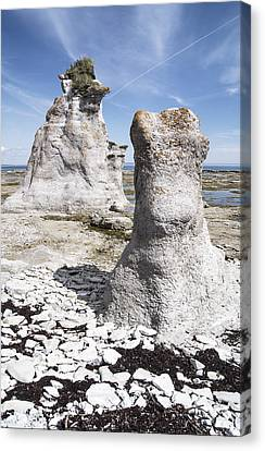 Canvas Print featuring the photograph Two Sculpted Rocks On Naked Isld by Arkady Kunysz
