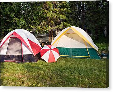 Two Tents And Umbrella Canvas Print by Marek Poplawski