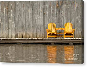 Two Wooden Chairs On An Old Dock Canvas Print by Les Palenik