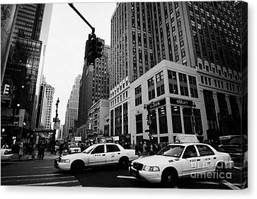 Two Yellow Cabs Cross Intersection Between Seventh 7th Avenue And 34th Street New York City Canvas Print by Joe Fox