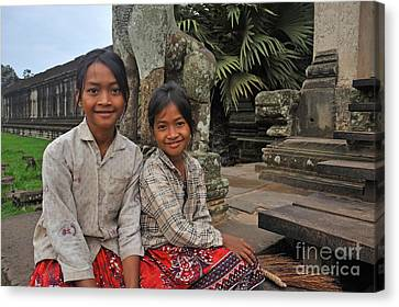Two Young Cambodian Girls In Angkor Wat Canvas Print by Sami Sarkis